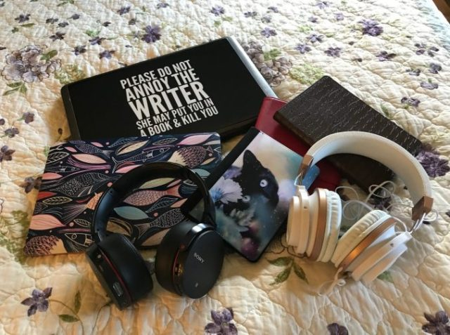 laptop, Mac book, Kindles and headphones